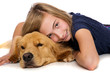 Young girl resting with her dog