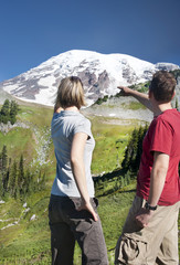 Couple admiring Mt. Rainier at Paradise, WA, USA