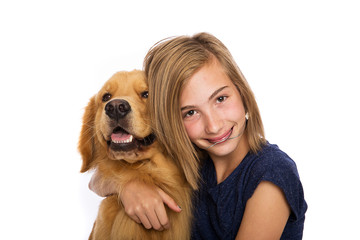 Teen girl with her golden retriever dog