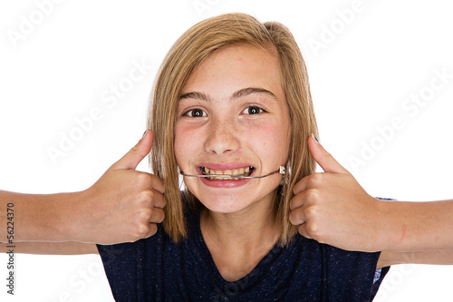 Happy young girl with headgear