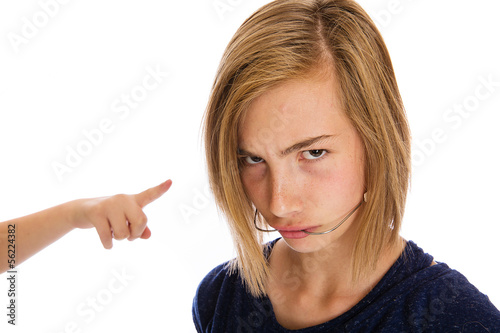 A mean bully pointing at a child