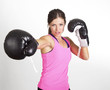 Woman boxing at a gym. Strong, fit woman in action