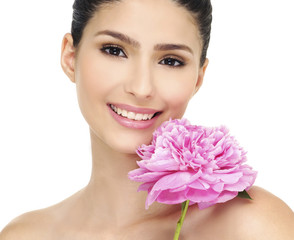 Young beautiful healthy girl with pink flower