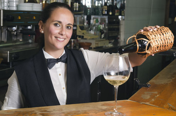 Waitress serving white wine