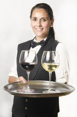 Waitress with tray and white and red wine