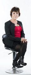 Mature businesswoman on a chair