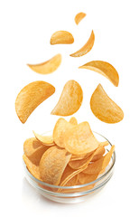 Bowl of patato chips isolated on white