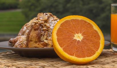 Orange  slices of orange with  croissants almond