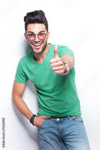 casual man shows the thumbs up sign