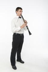 Handsome man plays clarinet