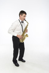 Handsome man plays saxophone