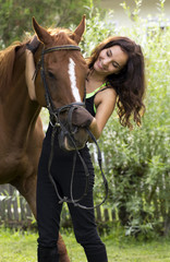 Woman holding horse