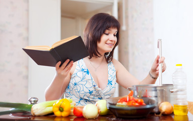 Young housewife  with cookery book