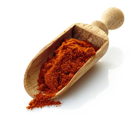 wooden scoop with paprika powder
