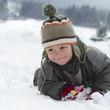 Child in winter snow