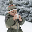 Child in winter drinking hot tea