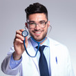 young doctor with stethoscope smiles