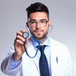 young doctor holding up stethoscope