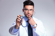 young doctor listens concentrated at stethoscope