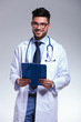 young doctor with clipboard in hands