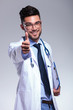 young doctor shows thumb up and smiles