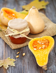 Pumpking jam on the rustic wooden background