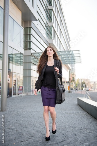 Business woman walking in hurry