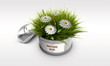 tin can with grass and flower