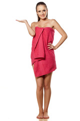 attractive young girl in a towel holding imaginary object