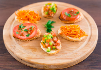 Delicious bruschetta with vegetables and herbs