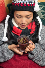girl drinking strong green tea