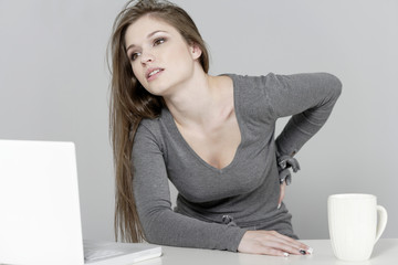 Woman at her desk in pain