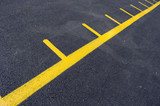 yellow row lines for kids at kindergarten on asphalt