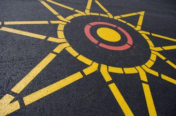 compass shape painted on asphalt