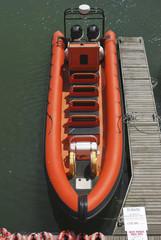 Orange RIB in Brighton Marina. Sussex. England