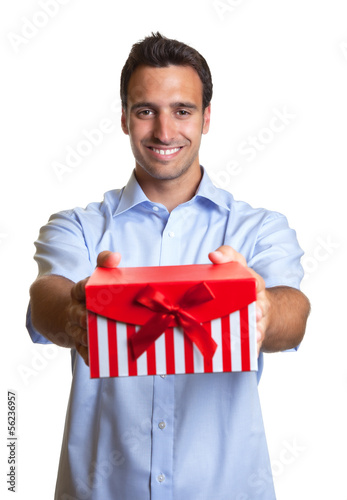Laughing latin man hands over the christmas present