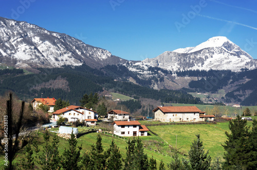 village in Aramaio valley, with snowy mountains. Basque Country.