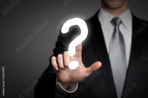 businessman pressing touchscreen questionmark - question