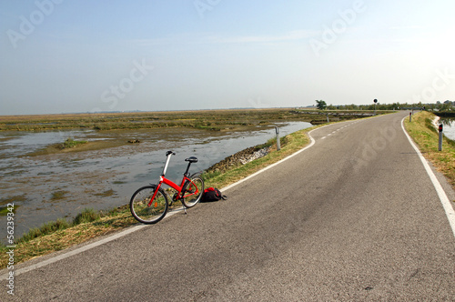 trekking bike for a ride in the middle of the Venetian Lagoon ne