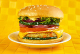 Vegetarian burger on plate , yellow background