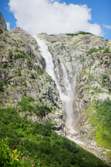Waterfall high in Caucasus mountains in Georgia