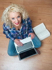 attractive woman with laptop and book