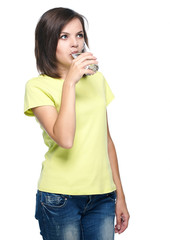 Attractive young woman in a yellow shirt and blue jeans. Drinkin