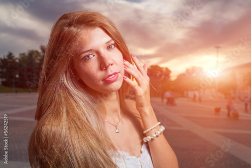 beautiful girl in the street at evening or night, sunset light
