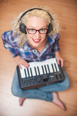 attractive woman playing music keyboard