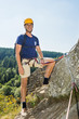 Confident Male Climber Standing On Rock