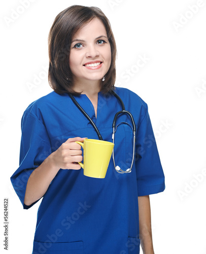 Attractive young nurse in uniform. Holds a yellow cup. Isolated