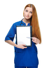 Attractive young nurse with a stethoscope. Holds poster and poin