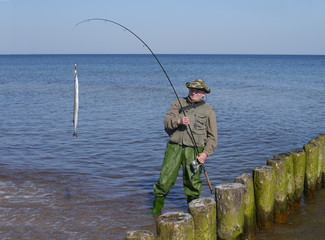 man with fish and  fishing-rod