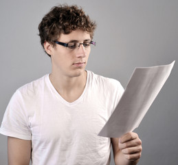 young Men reading informations